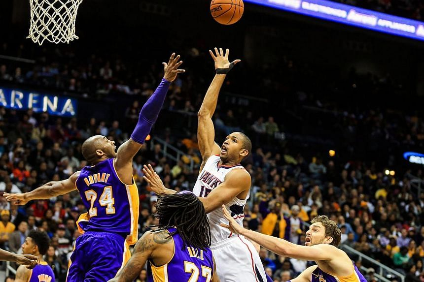 Atlanta Hawks centre Al Horford (15) shooting over Los Angeles Lakers' Kobe Bryant (24) in the second half at Philips Arena on Dec 16, 2013. The Atlanta Hawks dealt the struggling Los Angeles Lakers another NBA defeat en route to a 114-100 victory. -