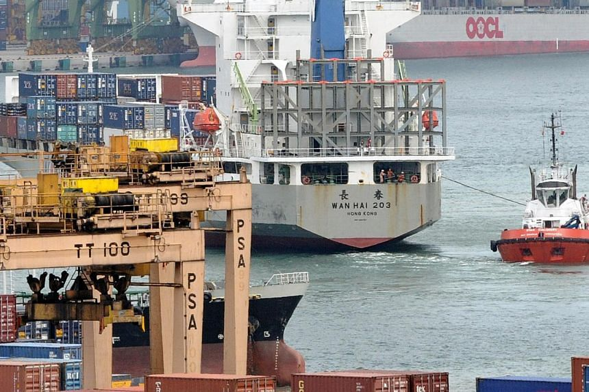 Singapore's non-oil domestic exports (Nodx) fell 8.8 per cent in November, due to declines in both electronic and non-electronic exports. -- FILE PHOTO: AFP