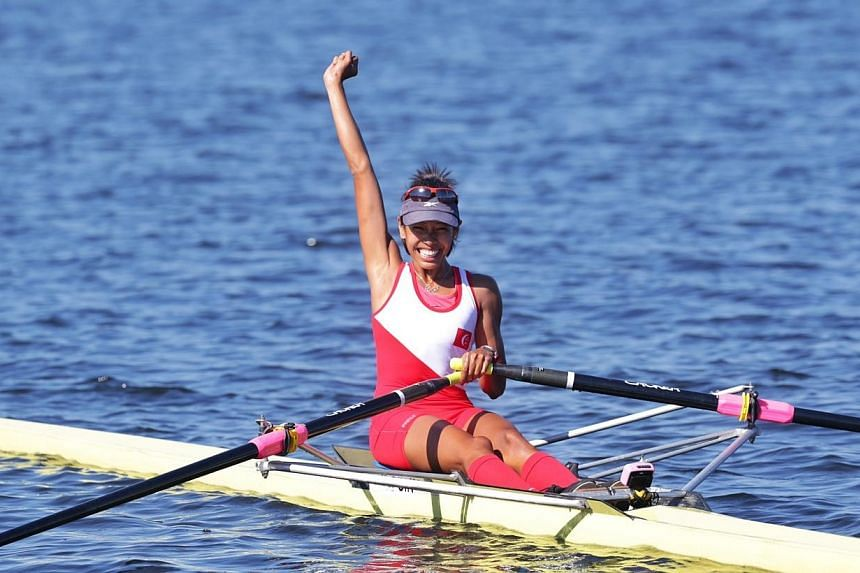 Singapore's Saiyidah Aisyah Mohamed Rafa'ee wins the gold medal in rowing's lightweight single sculls category at Ngalaik dam during the 27th SEA Games in Naypyidaw, Myanmar, on Tuesday, Dec 17 2013. -- ST PHOTO: KEVIN LIM