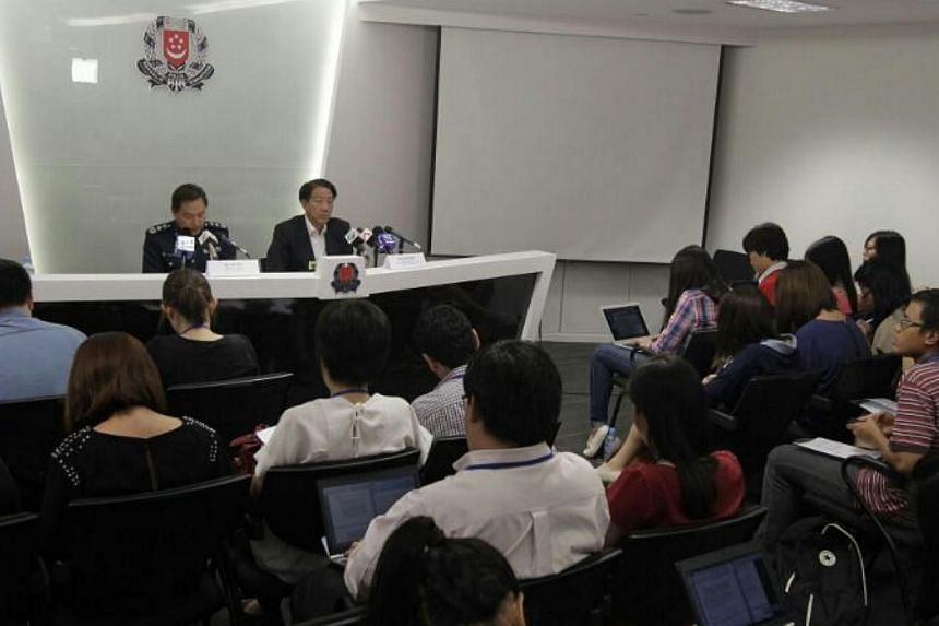 Commissioner of police Ng Joo Hee and DPM Teo Chee Hean chairing a press conference to update on the Little India riot investigations. -- ST PHOTO: CHEW SENG KIM