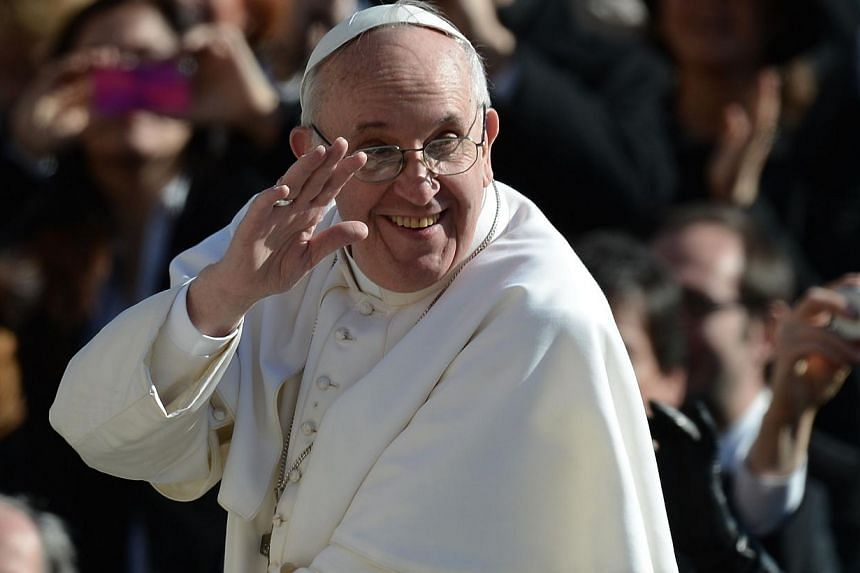 Pope Francis waves to the crowd from the papamobile during his inauguration mass at St Peter's square on March 19, 2013 at the Vatican. The Pope celebrated his 77th birthday on Dec 17, 2013. -- FILE PHOTO: AFP