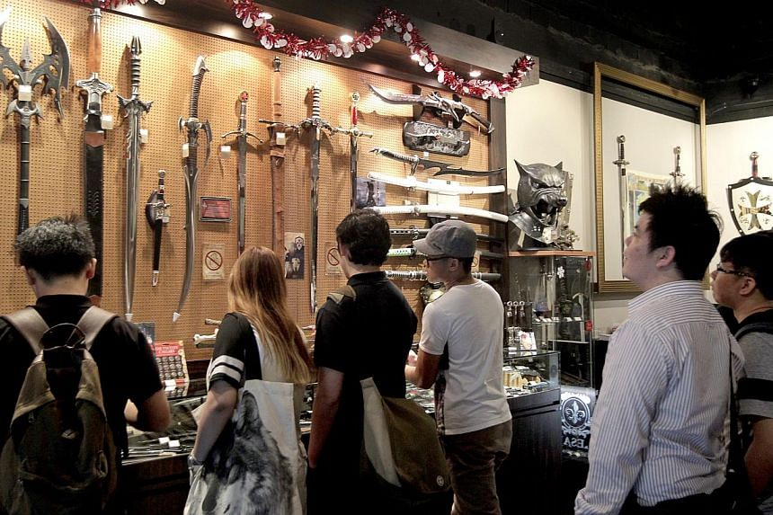 Shops like Caesars, which sells Japanese swords and other collectibles, said the variety of swords they have brought in over the years has expanded in range and they can cost up to tens of thousands of dollars. -- ST PHOTO: CHEW SENG KIM