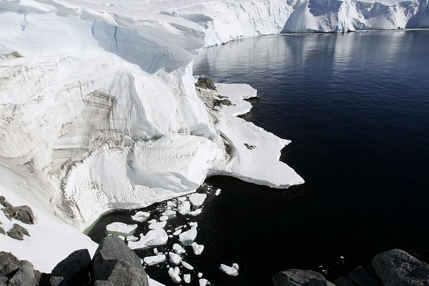 Melting ice shows through at a cliff face at Landsend, on the coast of Cape Denison in Antarctica on Dec 12, 2009. A type of rock that often bears diamonds has been found in Antarctica for the first time in a hint of mineral riches in the vast,