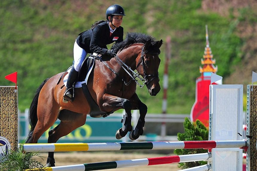 Singapore's equestrian rider Janine Khoo clinched a SEA Games gold medal in the individual show-jumping competition on Wednesday.  -- PHOTO: SINGAPORE SPORTS COUNCIL