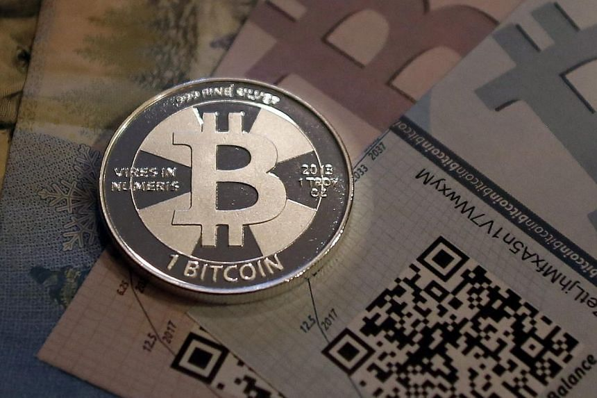 One of Bitcoin enthusiast Mike Caldwell's coins in this photo illustration at his office in Sandy, Utah, from September 17, 2013. The price of the digital currency bitcoin soared above $1,000 for the first time on Nov 27, 2013, extending a surge this