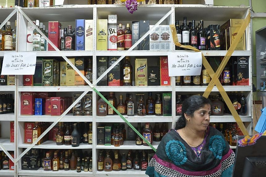 Notices put up at a shop selling liquor in Little India, where the sale of alcohol was banned on Dec 14 and 15 2013. The ban of alcohol was put in place following a riot that occurred in Little India on Dec 8 2013. Alcohol consump