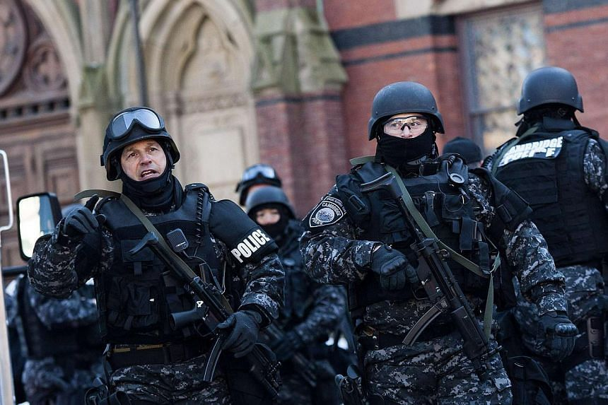 State and local police respond to reports of explosives at Harvard University in Cambridge, Massachusetts, on Dec 16, 2013.A Harvard University student charged with masterminding a bomb hoax to get out of an exam will appear before a US court i