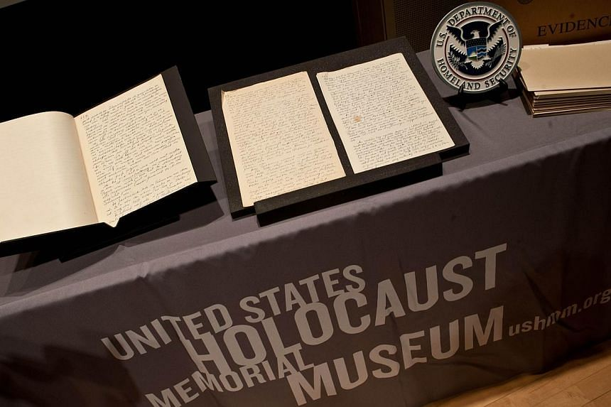 Pages from the diary of German Nazi ideologue Alfred Rosenberg are displayed at the Holocaust Memorial Museum in Washington on Dec 17, 2013 as the US Immigration and Customs Enforcement (ICE) agency hands over the document to the museum.The Uni