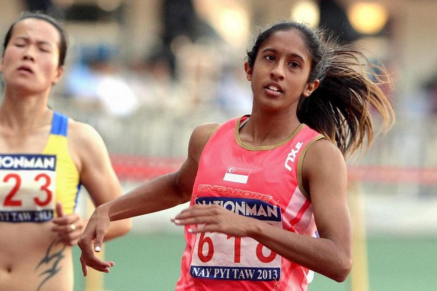 Singapore runner Shanti Pereira clocked a new national record in the women's 200m heats on Wednesday morning with a time of 24.12 seconds. -- ST PHOTO:LIM SIN THAI