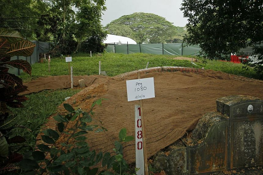 An exhumed grave at Bukit Brown Cemetery. The public exhumation began on Tuesday. A total of 304 graves have already been exhumed privately by family members. In all, 1,263 graves have been claimed to date.
