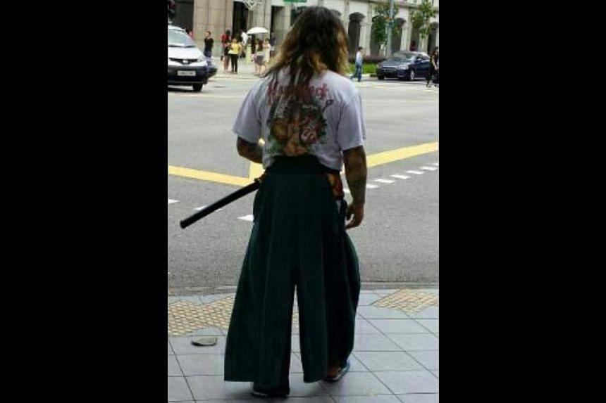 A man believed to be Chua wielding a sword.