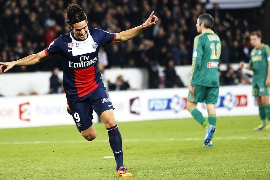 Paris Saint-Germain's Uruguayan forward Edinson Cavani celebrates after scoring a goal during the French League Cup round of sixteen football match between Paris Saint-Germain (PSG) and Saint-Etienne (ASSE) on Dec 18, 2013. A double by Cavani el