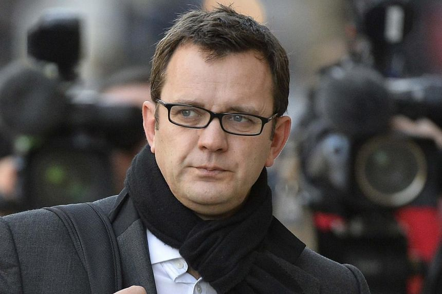 Former News of the World editor Andy Coulson arrives at the Old Bailey courthouse in central London Dec 18, 2013. Coulson is among eight defendants on trial on various charges related to phone-hacking, illegal payments to officials for stories, and h