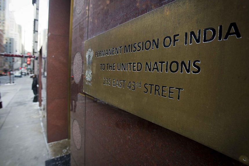 People walk past the Indian Mission to the United Nations building in New York on Dec 18, 2013.  India has transferred Devyani Khobragade, a deputy consul general at the Indian Consulate in New York whose arrest led to a diplomatic row between t