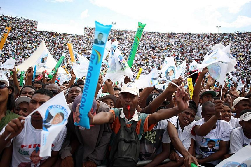 Supporters of Jean Louis Robinson, Presidential candidate of the AVANA Party, attend his last rally in Antananarivo on Dec 18, 2013. Madagascans return to polling stations on Friday to choose a new president in a run-off vote aimed at ending a politi