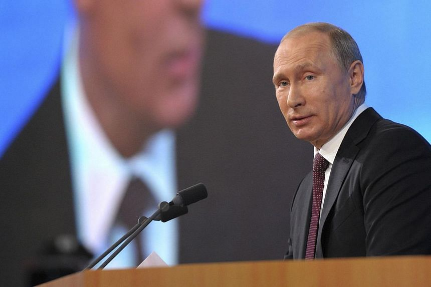 Russian President Vladimir Putin takes part in a televised news conference in Moscow, on December 19, 2013.President Putin said on Thursday, dec 19, 2013, that Russia had not yet decided to place nuclear-capable Iskander missiles in the exclave