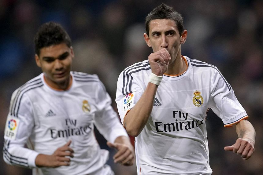 Real Madrid's Argentinian midfielder Angel di Maria (right) celebrates after scoring during the Spanish Copa del Rey (King's Cup) finals stage second-leg football match Real Madrid CF vs Olimpic de Xativa at the Santiago Bernabeu stadium in Madrid.&n