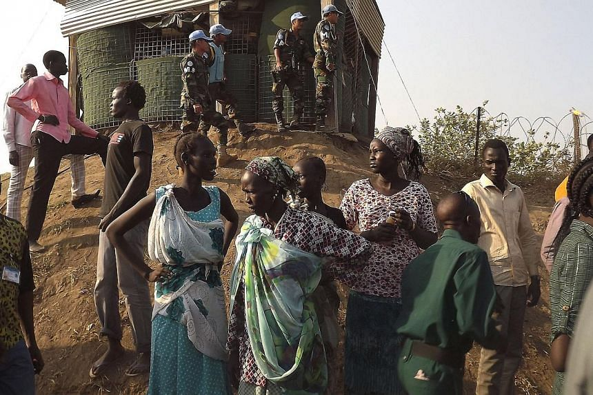 People arrive to seek refuge in the Unmiss compound in Juba, on Dec 18, 2013. The United Nations is warning that violence was spreading in South Sudan, as fierce fighting in the world's youngest nation prompted the US to evacuate Americans and other