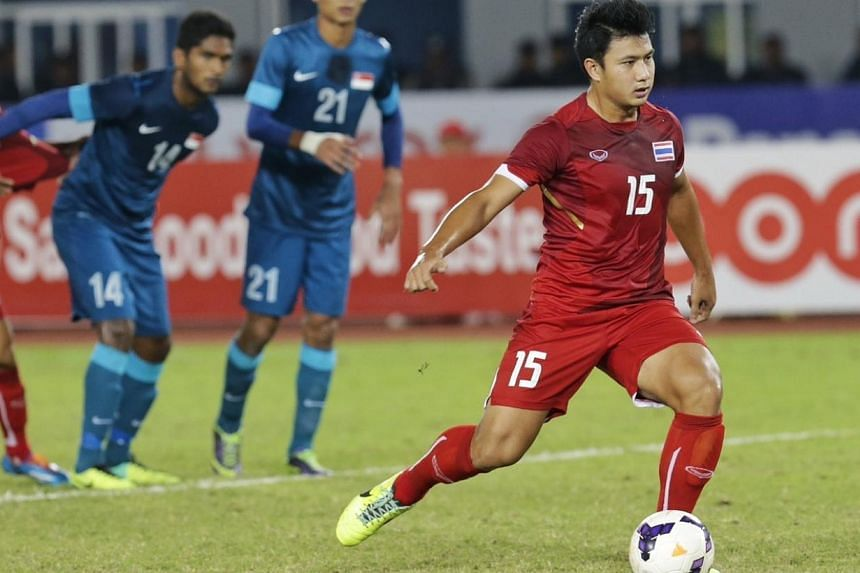 Thailand's Praweenwat Boon Yong hits a penalty for a 1-0 lead against Singapore in the football semifinal during the 27th SEA Games in Naypyidaw's Zeyar Thiri Stadium, Myanmar, on Dec 19, 2013. -- ST PHOTO: KEVIN LIM
