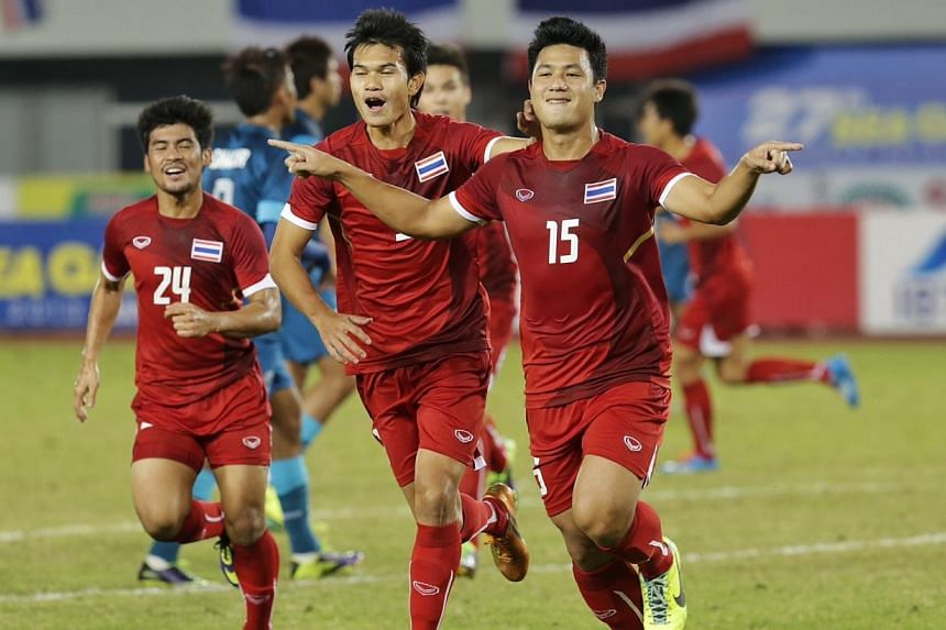 Thailand's Praweenwat Boon Yong celebrates after scoring a penalty for a 1-0 lead against Singapore in the football semifinal during the 27th SEA Games in Naypyidaw's Zeyar Thiri Stadium, Myanmar, on Dec 19, 2013. -- ST PHOTO: KEVIN LIM