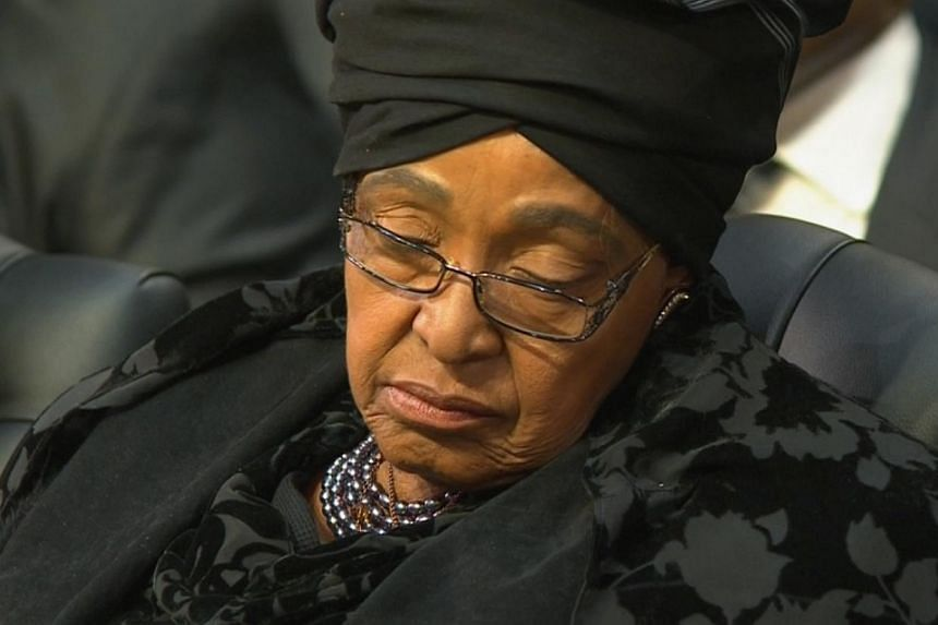 Ms Winnie Madikizela-Mandela, the ex-wife of former South African President Nelson Mandela, attends his funeral in his ancestral village of Qunu in the Eastern Cape province. Ms Madikizela-Mandeladenied on Wednesday there was a dynastic battle