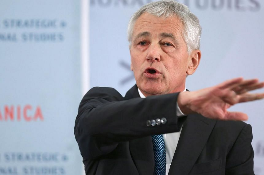 File picture of US Defence Secretary Chuck Hagel delivering a keynote address during the Center for Strategic and International Studies' 2013 Global Security Forum last month. -- PHOTO: AFP