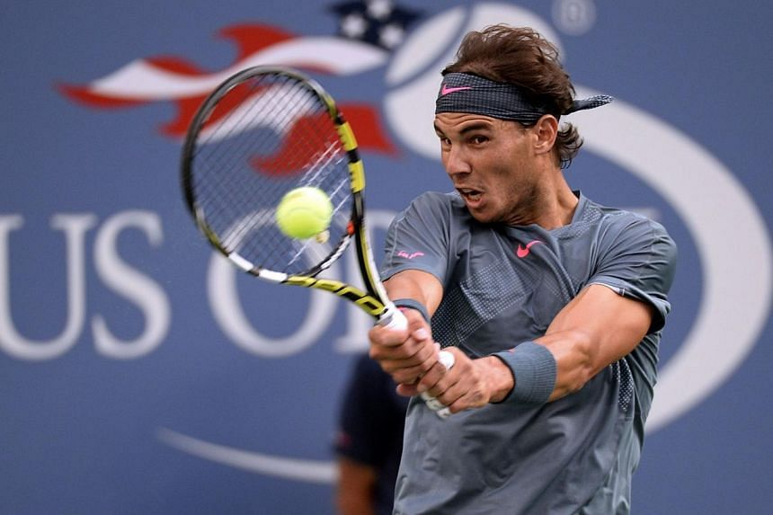 Rafael Nadal of Spain playing a shot during the 2013 US Open men's singles final, at the USTA Billie Jean King National Tennis Center, in New York, on Sept 9, 2013. Tennis champions Rafael Nadal and Serena Williams have been named as sportsman a