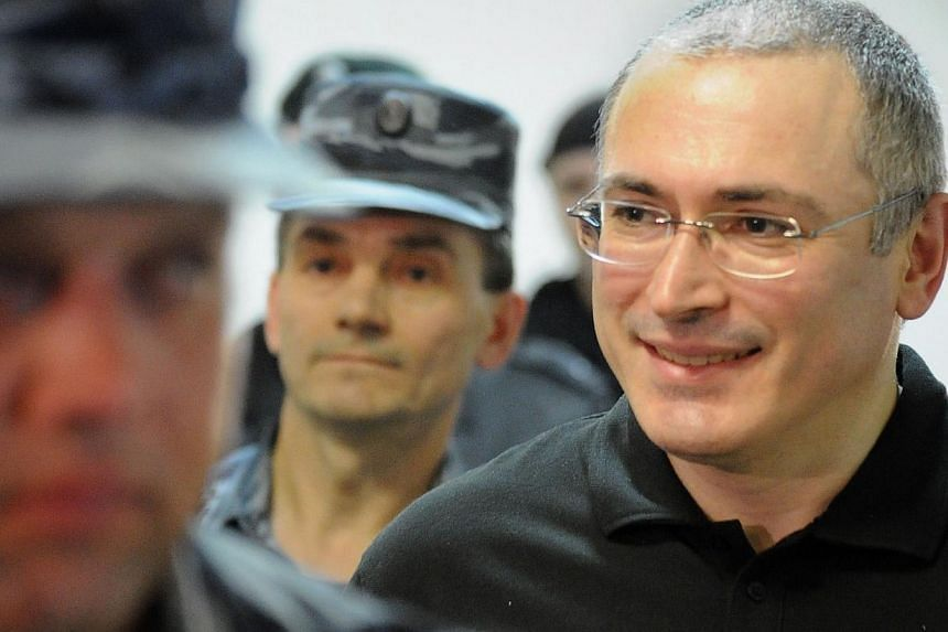 Former tycoon and bitter Kremlin critic Mikhail Khodorkovsky, is being escorted to a courtroom in Moscow on June 3, 2011. Khodorkovsky was Friday freed from his prison camp after receiving a pardon from President Vladimir Putin, the Interfax news age