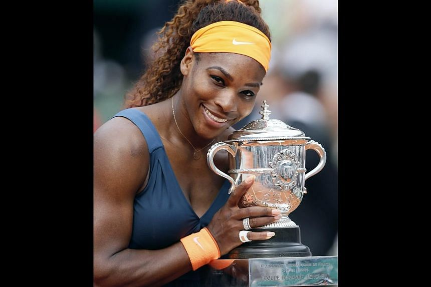 USA's Serena Williams poses with the Suzanne-Lenglen trophy after winning the 2013 French tennis Open final against Russia's Maria Sharapova, at the Roland Garros stadium in Paris, on June 8, 2013. -- PHOTO: AFP