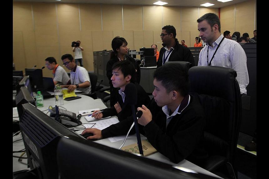 SBS Transit staff at the Downtown Line Stage 1 temporary operations control centre in Kim Chuan Depot.