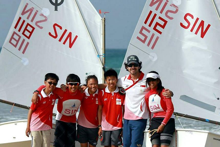 Singapore's Optimist sailors consisting of (from left) Raynn Kwok, Edward Tan, Bertha Han, Isaac Tang, coach Fernando Alegre and Fathin Rasyqin Firdaus. The team has clinched at least four titles at the ongoing SEA Games, held at the Ngwe Saung