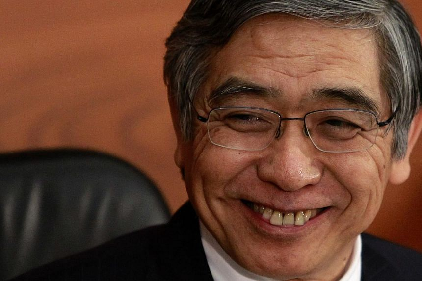 Bank of Japan Governor Haruhiko Kuroda attends a news conference at the BOJ headquarters in Tokyo on Oct 31, 2013. The Bank of Japan kept monetary policy steady on Friday and maintained its view that the economy is recovering moderately, encoura