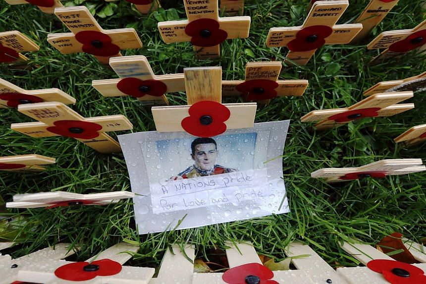 A photograph of Drummer (Private) Lee Rigby of the Royal Regiment of Fusiliers is pictured in the Field of Remembrance at Westminster Abbey in London in this Nov 9, 2013 photo.Two British Muslim converts were found guilty of murder on Thursday