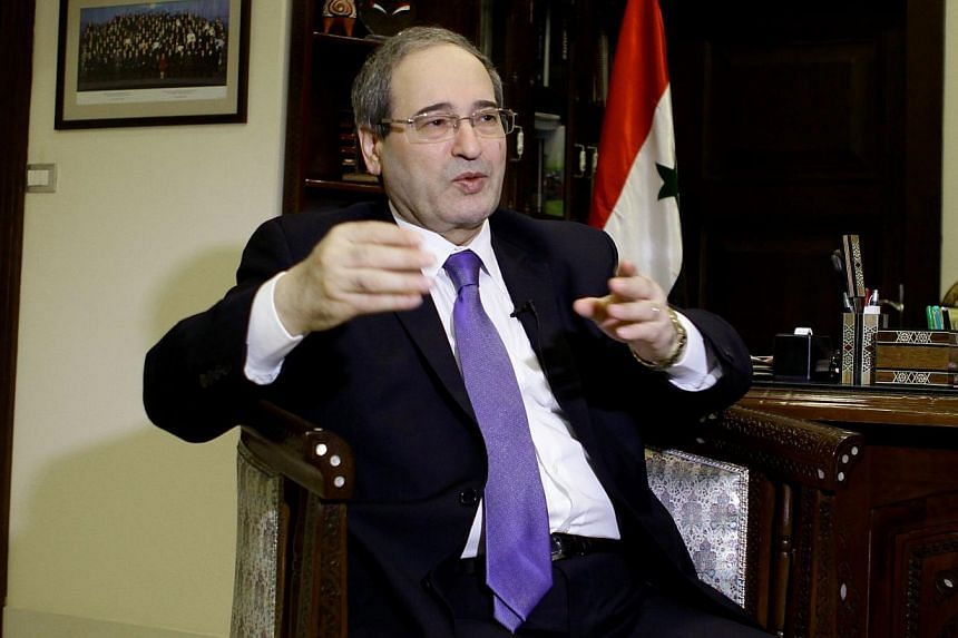 Syrian deputy foreign minister Faisal Muqdad speaks to an AFP journalist in the capital Damascus on Dec 19, 2013.A senior Syrian official said nobody can stop embattled President Bashar al-Assad from seeking re-election and that a government te