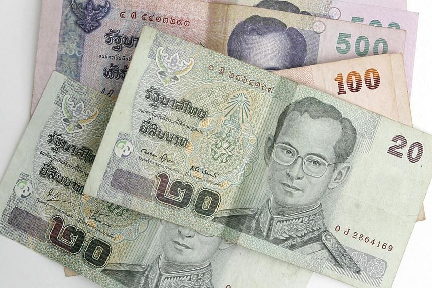The Thai baht set a three-year low and the Indonesian rupiah hit a five-year trough on Friday, as the US dollar stayed buoyant in the wake of the Federal Reserve's decision to start scaling back its bond-buying stimulus. -- ST FILE PHOTO:CAROLI