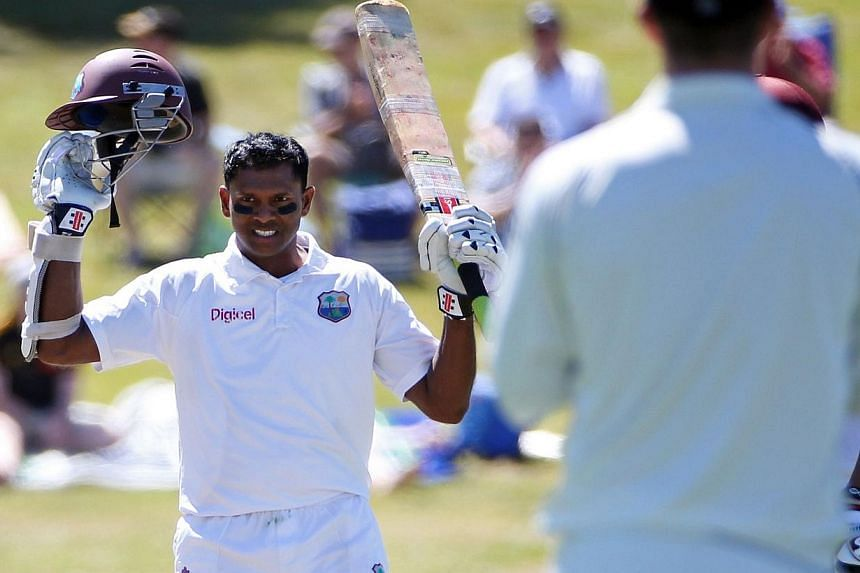 Shivnarine Chanderpaul of the West Indies celebrates his century during day two of the third international cricket Test match between New Zealand and the West Indies at the Seddon Park in Hamilton on Dec 20, 2013. -- PHOTO: AFP