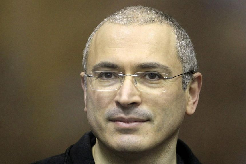 Jailed Russian former oil tycoon Mikhail Khodorkovsky stands in the defendants' cage before the start of a court session in Moscow on Dec 28, 2010. -- FILE PHOTO: REUTERS