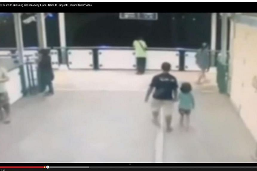 Pictures of six-year-old Nong Cartoon began circulating on social media and went viral after CCTV footage showed her at Bearing station with a man holding her hand. -- PHOTO: SCREENGRAB FROM YOUTUBE