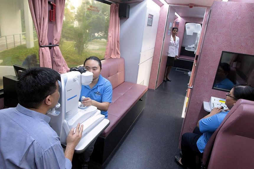 A person getting his eyes examined onboard a mobile clinic by Singapore Anti-Tuberculosis Association CommHealth (SATA CommHealth). Three organisations won the 2013 President's Challenge Social Enterprise Award on Friday, Dec 20, 2013. -- FILE PHOTO: