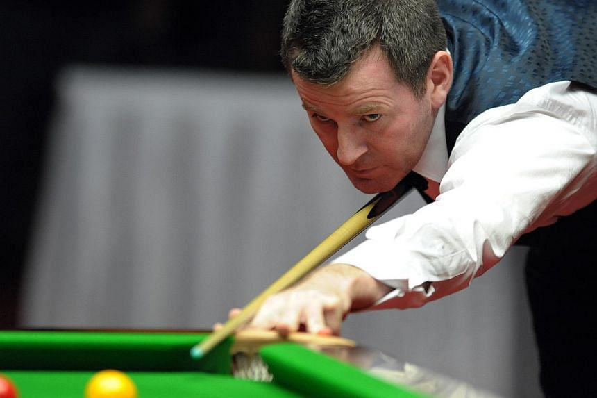 Singapore's Peter Gilchrist calculating a shot during the English billards singles final against Thailand's Praput Chaithanasakun at the 26th SEA Games in Palembang, Indonesia, on Nov 13, 2011. Gilchrist captured Singapore's first cue sports gold med