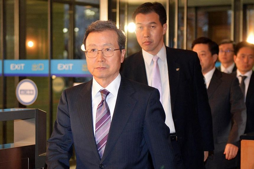 Chinese ambassador to Japan Cheng Yonghua (left) enters the foreign ministry in Tokyo to meet with Japanese Foreign Minister Fumio Kishida, on Dec 20, 2013. Japan's foreign minister and the Chinese envoy to Tokyo met on Friday, Dec 20, 2013, in a rar