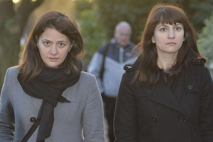 Sisters Francesca (right) and Elisabetta Grillo arrive at Isleworth Crown Court in west London, on Dec 19, 2013.Two personal assistants to celebrity cook Nigella Lawson were found not guilty on Friday, Dec 20, 2013, of defrauding money from the