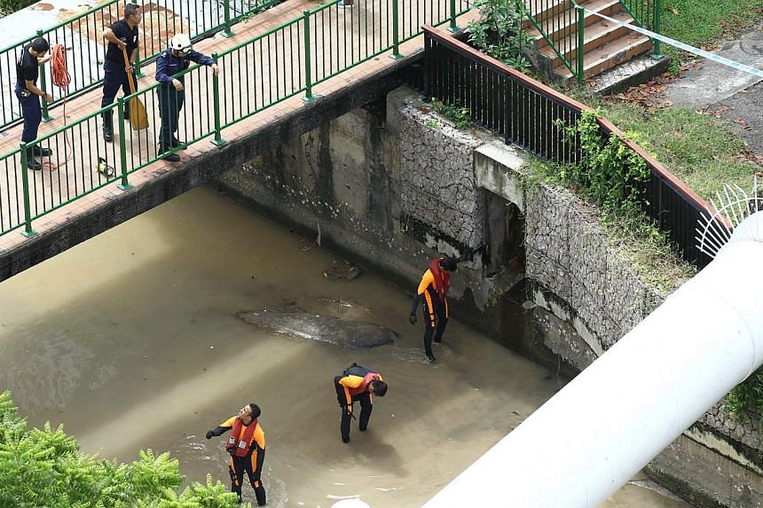 Singapore Civil Defence Force (SCDF) firefighters and divers searching for evidence at the Whampoa River and the surrounding areas after a decapitated body of a woman was found floating on the river. A forklift-driver was charged on Friday with the m