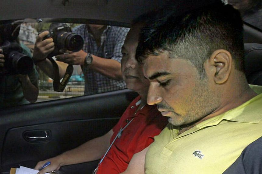 Gursharan Singh, 25, is accused of the murder of Ms Jasvinder Kaur, whose decapitated body was found in Whampoa River last week. He is seen arriving in sub courts on Friday morning. -- ST PHOTO: WONG KWAI CHOW