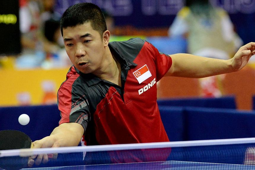 Singapore won its 32nd and 33rd golds at the SEA Games in Naypyidaw on Saturday, when Zhan Jian (in photo) and Yu Mengyu won the men's and women's table tennis singles golds respectively. -- FILE PHOTO: BH