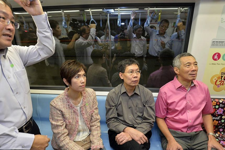 Prime Minister Lee Hsien Loong taking a ride along the new Downtown Line on Dec 21, 2013. With him are (from left) Land Transport Authority (LTA) deputy chief executive of infrastructure and development Chua Chong Kheng, Senior Minister of State for