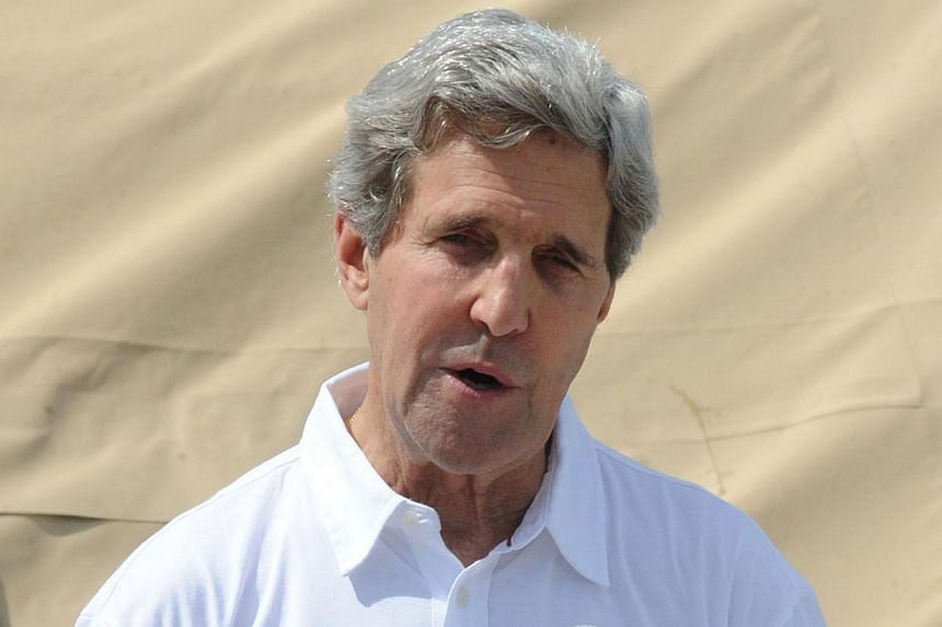 US Secretary of State John Kerry(above) gestures as he speaks during his visit to the typhoon ravaged city of Tacloban in the central Philippines on Dec 18, 2013. MrKerry said he was sending a special envoy to South Sudan to help foster dialogu
