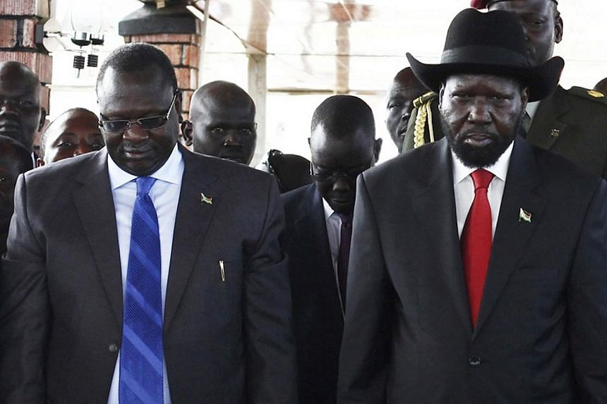 South Sudan's then Vice-President Riek Machar (left) and President Salva Kiir pay their respects at John Garang's Mausoleum, during the celebration of the 2nd anniversary of South Sudan becoming an independent state, in Juba, on July 9, 2013. A top S