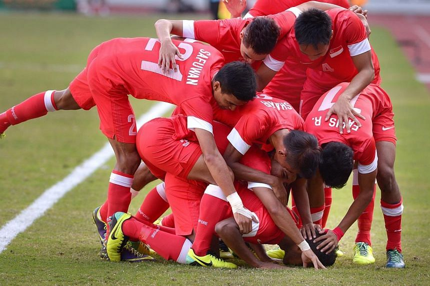 Young Lions celebrate Hariss Harun's first goal. Singapore beat Malaysia 2-1 to win the bronze medal match of the 27th SEA Games in Naypyitaw, Myanmar, on Saturday, Dec 21, 2013. -- ST PHOTO: LIM SIN THAI