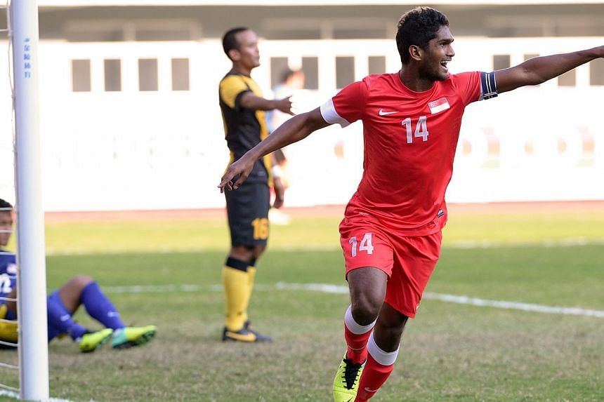 Hariss Harun (right) reacts after scoring his second goal. Singapore beat Malaysia 2-1 to win the bronze medal match of the 27th SEA Games in Naypyitaw, Myanmar, on Saturday, Dec 21, 2013. -- ST PHOTO: LIM SIN THAI